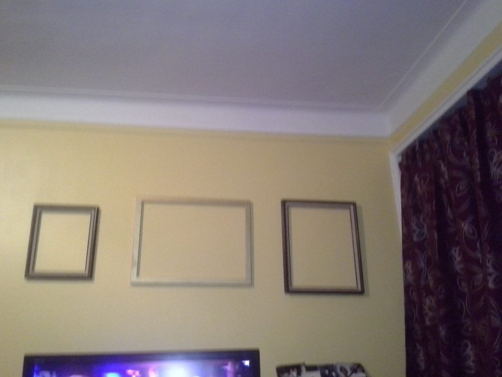 Action faith and three empty picture frames for What to do with empty picture frames